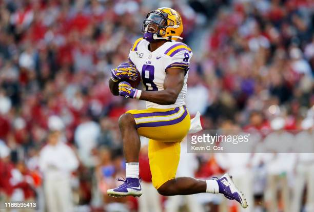 Patrick Queen of the LSU Tigers celebrates after intercepting a pass during the second quarter against the Alabama Crimson Tide in the game at...