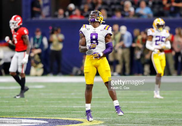 Patrick Queen of the LSU Tigers celebrates in the second half against the Georgia Bulldogs during the SEC Championship game at MercedesBenz Stadium...