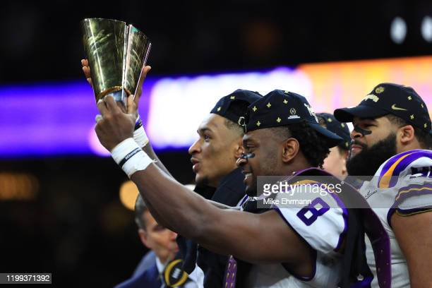 Patrick Queen of the LSU Tigers celebrates with the trophy after defeating the Clemson Tigers 4225 in the College Football Playoff National...