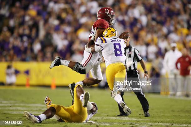 Patrick Queen of the LSU Tigers hits Tua Tagovailoa of the Alabama Crimson Tide in the second quarter of their game at Tiger Stadium on November 03...