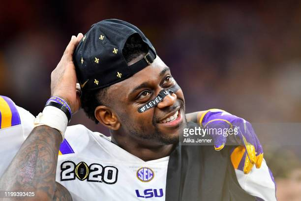 Patrick Queen of the LSU Tigers is all smiles on the championship stage after the College Football Playoff National Championship game against the...