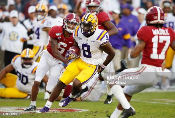 Patrick Queen of the LSU Tigers runs after intercepting a pass during the second quarter against the Alabama Crimson Tide in the game at BryantDenny...