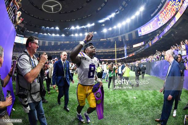 Patrick Queen of the LSU Tigers waves to fans after the College Football Playoff National Championship game against the Clemson Tigers at the...