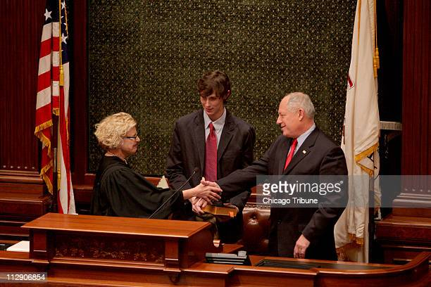 Patrick Quinn watches as Illinois Justice Anne Burke congratulates his father Pat Quinn who was sworn in as governor of Illinois on Thursday January...