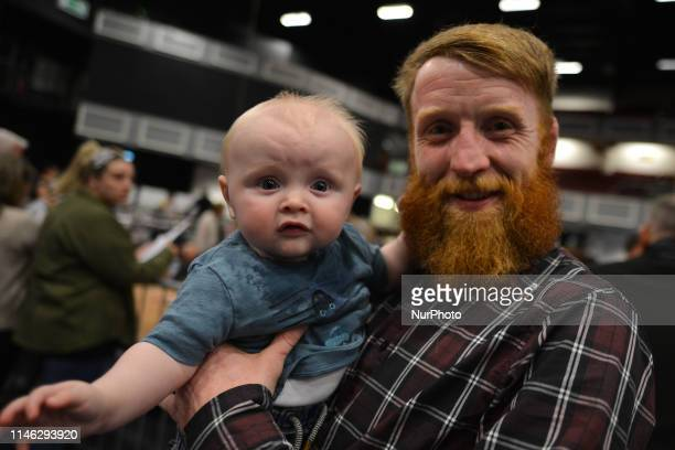 """Patrick """"Paddy"""" Holohan, a retired Irish mixed martial artist and a Sinn Féin local election candidate for Tallaght South, holds his son..."""