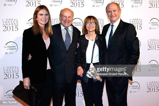 Patrick Rabin with his wife standing between Chairman Chief Executive Officer of L'Oreal and Chairman of the L'Oreal Foundation JeanPaul Agon with...