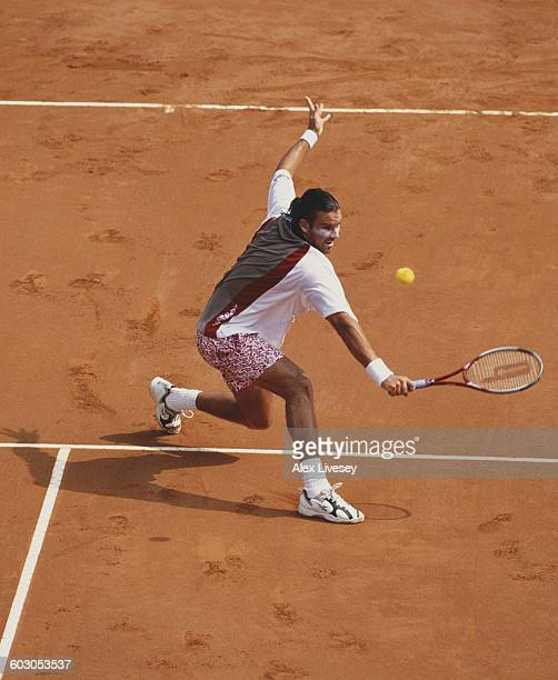 Patrick Rafter of Australia returns against Gustavo Kuerten during their Men's Singles Final match at the Italian Open Tennis Championship on 16 May...