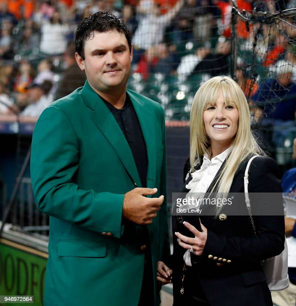 Patrick Reed 2018 Masters champion and wife Justine after receiving a Houston Astros jersey from owner Jim Crane at Minute Maid Park on April 14 2018...