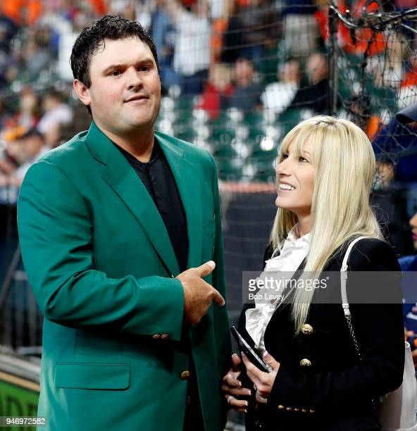 Patrick Reed, 2018 Masters champion and wife Justine after receiving a Houston Astros jersey from owner Jim Crane at Minute Maid Park on April 14,...