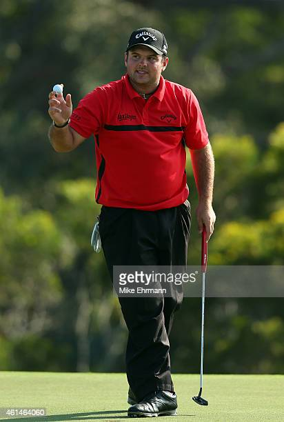 Patrick Reed acknowledges the gallery on the 18th green on his way to a playoff with Jimmy Walker during the final round of the Hyundai Tournament of...