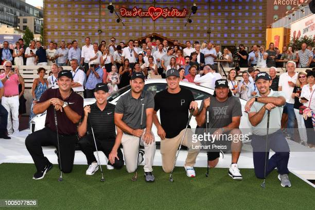 Patrick Reed, Alexander Knappe, Jordan Smith, Bryson DeChambeau, Pat Perez and Charl Schwartzel pose during the Porsche Urban Golf Challenge on the...