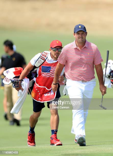 Patrick Reed and his caddy Kessler Karain walk to the 15th green during day one of the 2019 Presidents Cup at Royal Melbourne Golf Course on December...