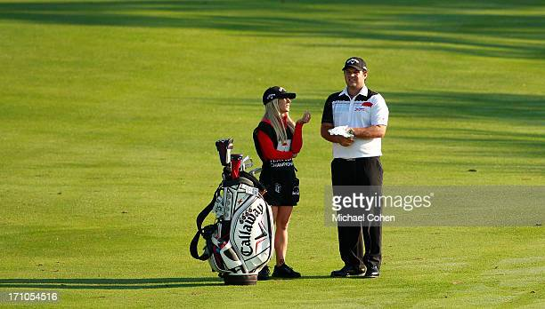 Patrick Reed and his wife and caddie Justine Reed prepare to play a shot during the second round of the Travelers Championship held at TPC River...