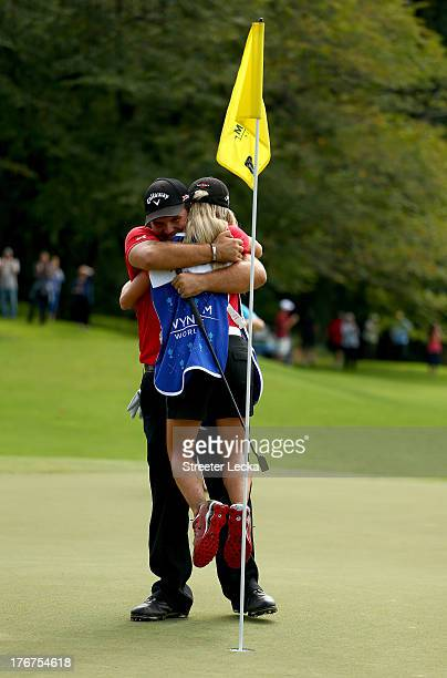 Patrick Reed and his wife Justine celebrate after defeating Jordan Spieth on the second hole of a playoff during the final round of the Wyndham...