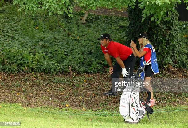 Patrick Reed and his wife Justine look over a shot on the 10th hole during a playoff against Jordan Spieth in the final round of the Wyndham...