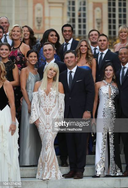 Patrick Reed and his wife Justine Reed pose with Team United States on the steps of the Palace of Versailles before the Ryder Cup gala dinner ahead...