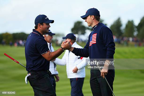Patrick Reed and Jordan Spieth of the United States celebrate victory on the 15th hole during the Morning Fourballs of the 2014 Ryder Cup on the PGA...