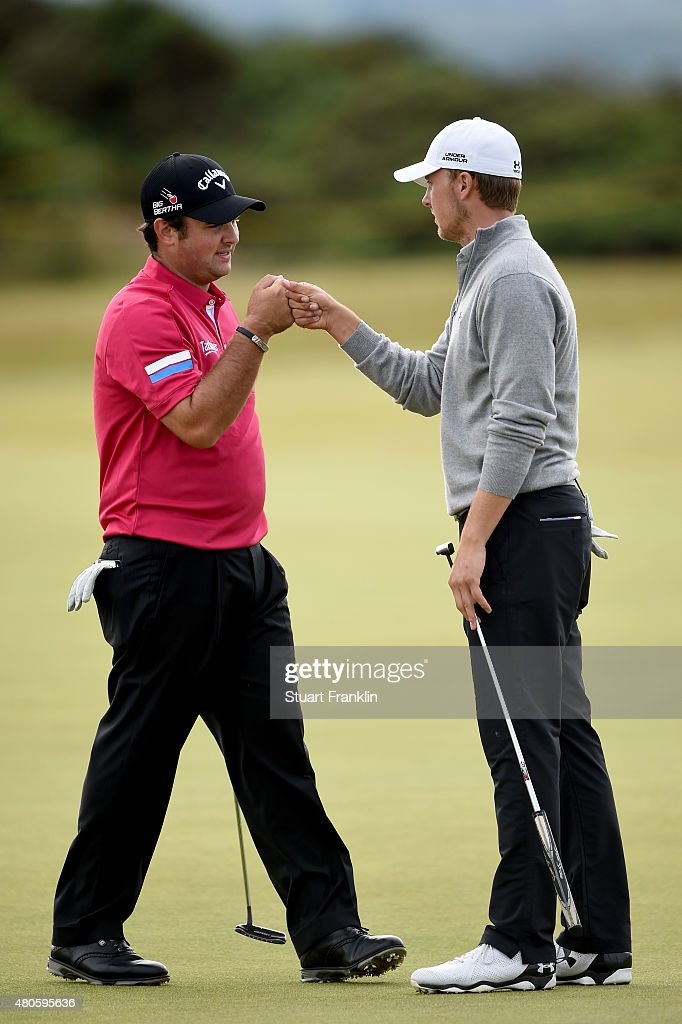 Patrick Reed and Jordan Spieth of the United States react as they play a practice round ahead of the 144th Open Championship at The Old Course on July 13, 2015 in St Andrews, Scotland.