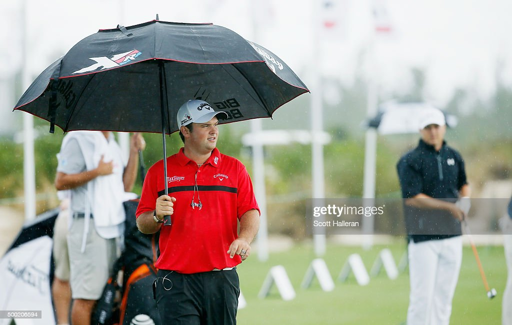 Patrick Reed (L) and Jordan Spieth of the United States wait on the practice ground during the final round of the Hero World Challenge at Albany, The Bahamas on December 6, 2015 in Nassau, Bahamas