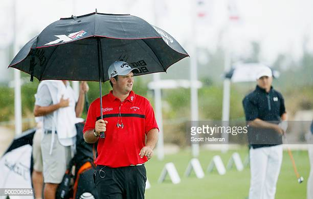 Patrick Reed and Jordan Spieth of the United States wait on the practice ground during the final round of the Hero World Challenge at Albany, The...