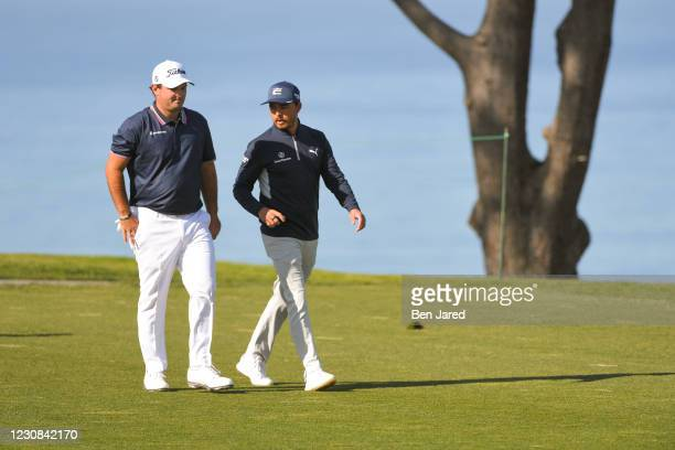 Patrick Reed and Rickie Fowler chat on the 11th hole on North course during the first round of the Farmers Insurance Open at Torrey Pines South on...