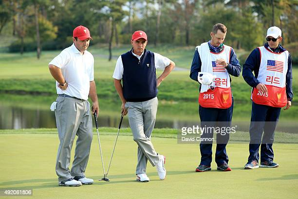Patrick Reed and Rickie Fowler of the United States team on the seventh hole in their match against Louis Oosthuizen and Branden Grace of the...