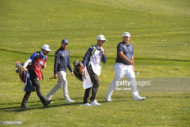 Patrick Reed and Rickie Fowler walk to on the 15th green on the North course during the first round of the Farmers Insurance Open at Torrey Pines on...