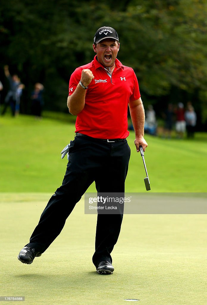 Patrick Reed celebrates after making a birdie to win, on the second hole of a playoff, against Jordan Spieth during the final round of the Wyndham Championship at Sedgefield Country Club on August 18, 2013 in Greensboro, North Carolina.