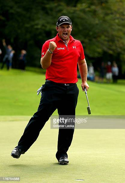 Patrick Reed celebrates after making a birdie to win, on the second hole of a playoff, against Jordan Spieth during the final round of the Wyndham...