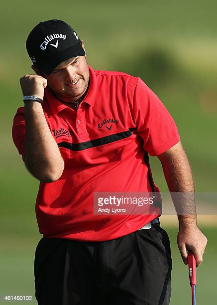 Patrick Reed celebrates winning after finishing a playoff on the 18th hole during the final round of the Hyundai Tournament of Champions at...