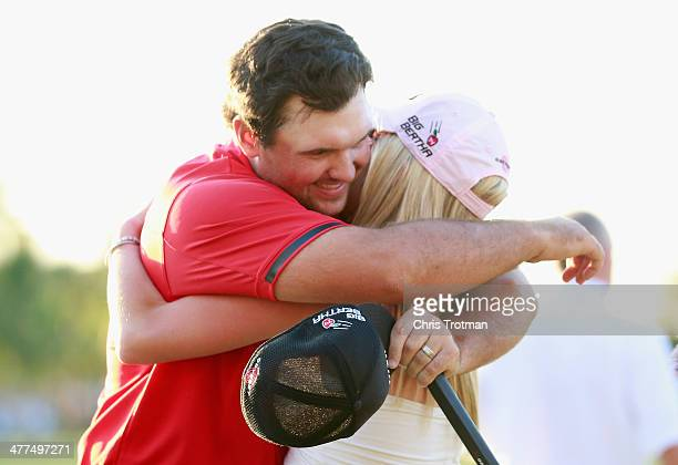 Patrick Reed celebrates with his wife Justine on the 18th green after his onestroke victory during the final round of the World Golf...