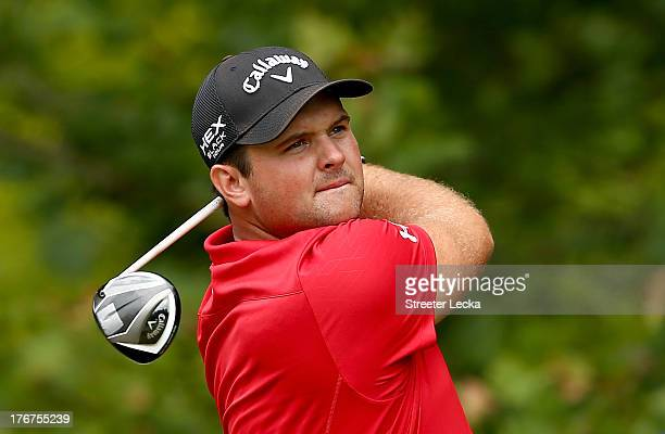 Patrick Reed hits a tee shot on the 13th hole during the final round of the Wyndham Championship at Sedgefield Country Club on August 18, 2013 in...