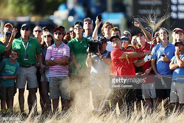 Patrick Reed hits his second shot on the 16th hole during the final round of The Barclays in the PGA Tour FedExCup PlayOffs on the Black Course at...