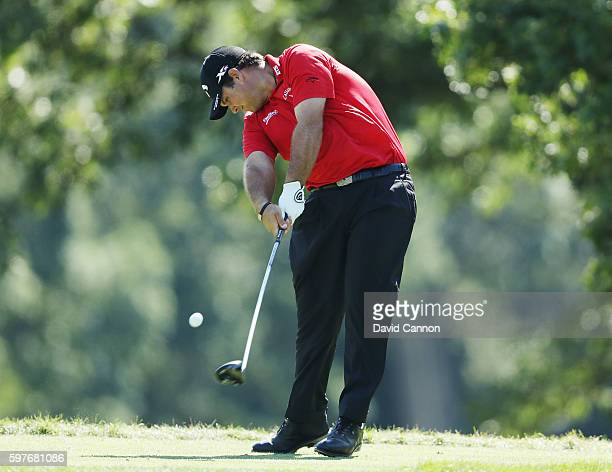 Patrick Reed hits his tee shot on the fifth hole during the final round of The Barclays in the PGA Tour FedExCup PlayOffs on the Black Course at...