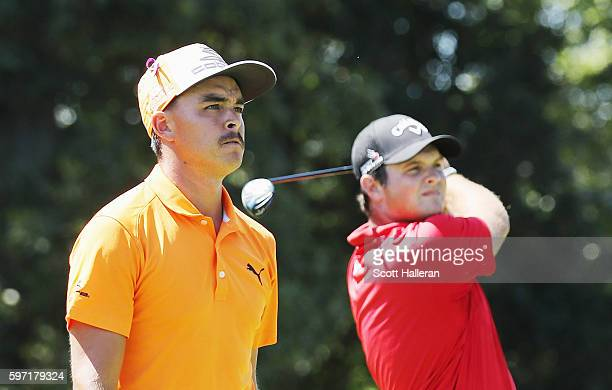 Patrick Reed hits his tee shot on the second hole as Rickie Fowler looks on during the final round of The Barclays in the PGA Tour FedExCup PlayOffs...