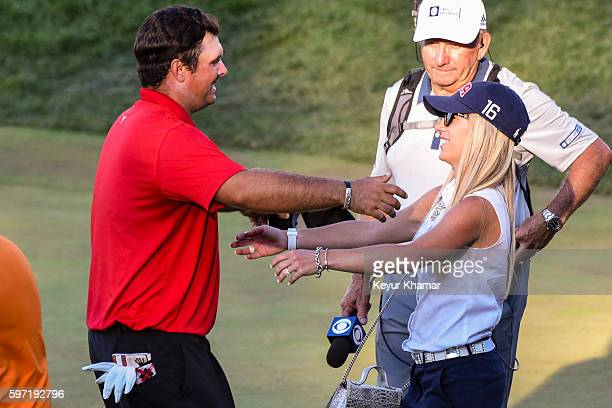 Patrick Reed hugs his wife Justine Reed following his one stroke victory on the 18th hole green during the final round of The Barclays at Bethpage...