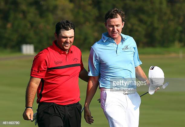 Patrick Reed is congratulated by Jimmy Walker after Reed defeated Walker in a playoff on the 18th hole to win the final round of the Hyundai...