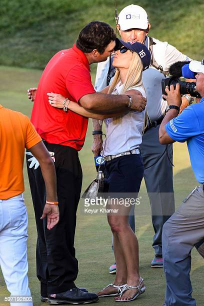 Patrick Reed kisses his wife Justine Reed following his one stroke victory on the 18th hole green during the final round of The Barclays at Bethpage...