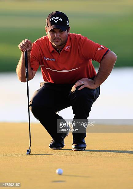 Patrick Reed lines up a putt on the 18th green during the final round of the World Golf ChampionshipsCadillac Championship at Trump National Doral on...