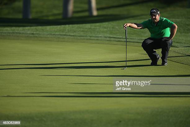Patrick Reed lines up a putt on the ninth hole of the Arnold Palmer Private Course at PGA West during the first round of the Humana Challenge in...
