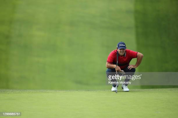 Patrick Reed lines up his putt on the 13th hole green during the final round of the Farmers Insurance Open at Torrey Pines South on January 31, 2021...