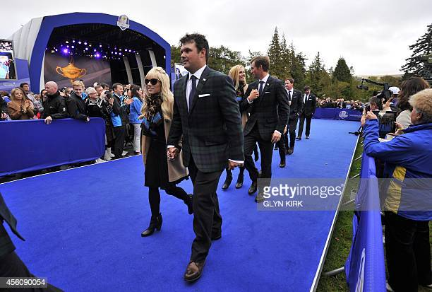 Patrick Reed of Team US and his partner Justine leave after attending the opening ceremony at the Gleneagles golf course in Gleneagles Scotland on...