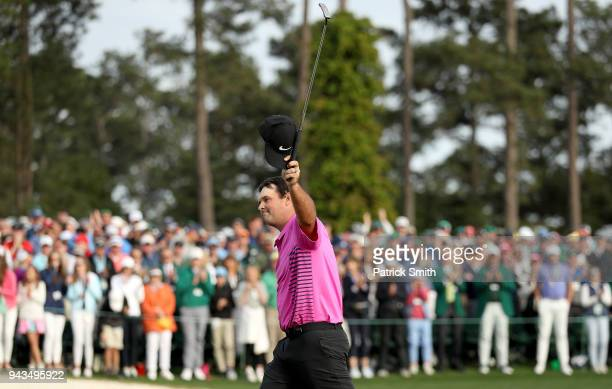 Patrick Reed of the United States acknowledges the crowd after making par 18th green during the final round to win the 2018 Masters Tournament at...