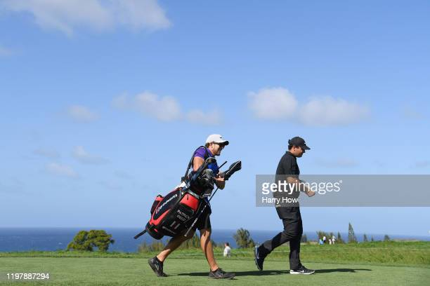 Patrick Reed of the United States and caddie Kessler Karain walk from the tenth tee during the final round of the Sentry Tournament Of Champions at...