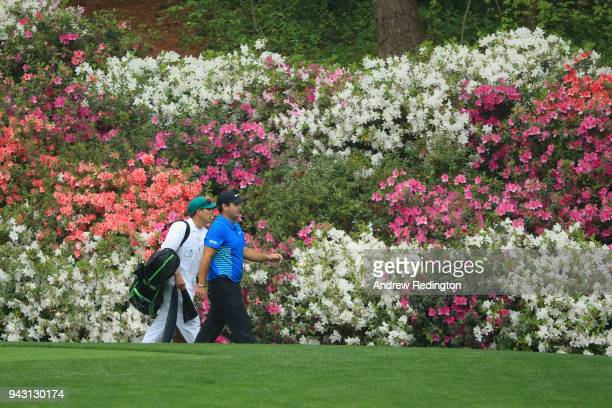 Patrick Reed of the United States and caddie Kessler Karain walk on the 13th hole during the third round of the 2018 Masters Tournament at Augusta...
