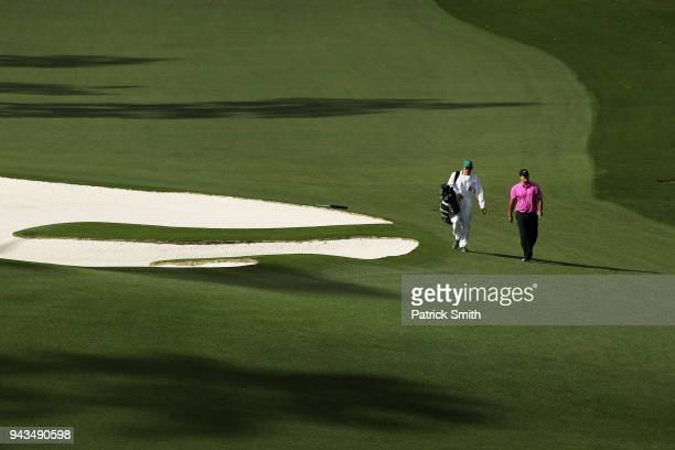 Patrick Reed of the United States and caddie Kessler Karain walk the tenth hole during the final round of the 2018 Masters Tournament at Augusta...