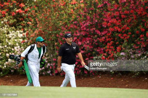 Patrick Reed of the United States and caddie, Kessler Karain, walk up the 13th fairway during the first round of the Masters at Augusta National Golf...