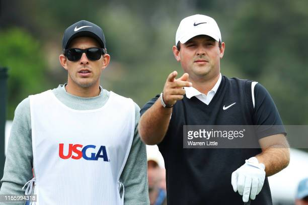 Patrick Reed of the United States and his caddie, Kessler Karain, talk on the third hole during the second round of the 2019 U.S. Open at Pebble...