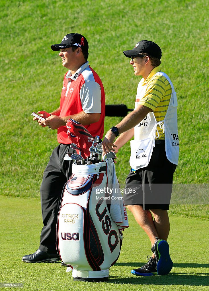 Patrick Reed of the United States and his caddie prepare for his shot on the 17th hole during the first round of the travelers Championship at TPC River Highlands on August 4, 2016 in Cromwell, Connecticut.