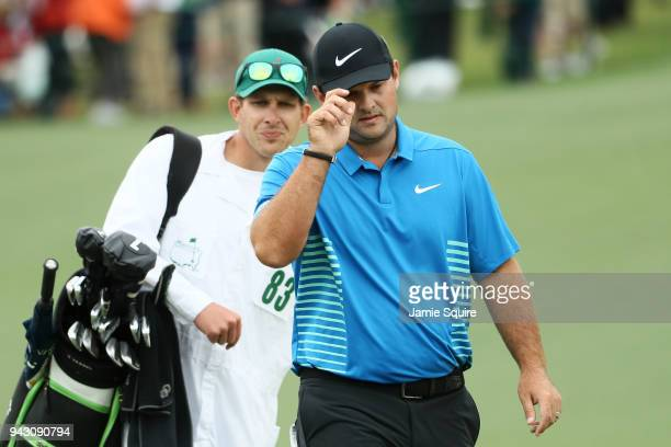 Patrick Reed of the United States and Kessler Karain walk up the second hole during the third round of the 2018 Masters Tournament at Augusta...